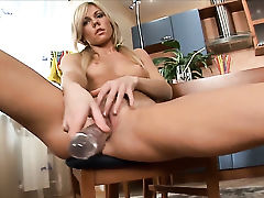 Janna fills the hole between her legs with sex toy