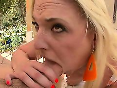 Young cute blonde Tristyn Kennedy with big round firm hooters gets on knees and