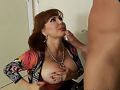 Sexy Vanessa is the bustiest and the hottest redhead sexy milf you will see in your life. She