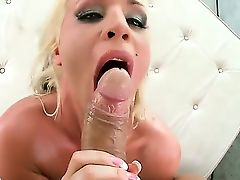 Long haired blonde bombshell Sadie Swede with big fake tits and round bouncing ass in
