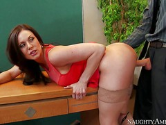 Long haired brunette Kendra Lust with sexy big boobs is
