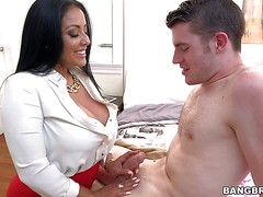 Kiara Mia is an elegant long haired milf brunette in