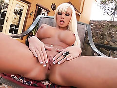 Rikki Six spends time fingering her love hole