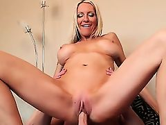 Slender blonde cougar Emma Starr with big tits and long whorish nails gets her shaved