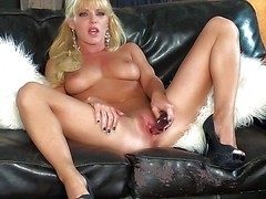 Gorgeous blonde Niki Young with sexy natural boobs and shaved