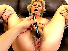 Hardcore and horny blonde granny Effie can not calm her sexual hunger and