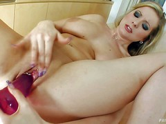Curvy blonde Allysia with heavy natural boobs spreads her legs