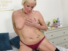 short haired blonde granny rubs her wet pussy