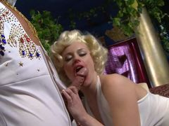 Curly haired blonde Codi Carmichael in snow white dress bares