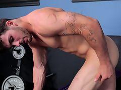 Muscular stud tugging his hard cock
