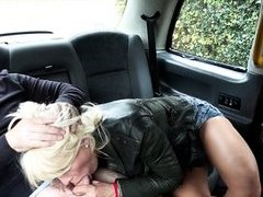 blonde opens her legs in the backseat