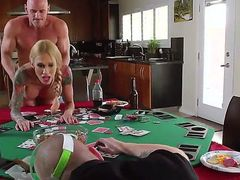 This hot and tattooed blonde porn star Sarah Jessie who likes cuckolding gets fucked on the table and in front