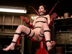 slave is bound in a bondage chair