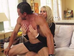 Blonde haired cougar Ryan Conner in white panties bares her