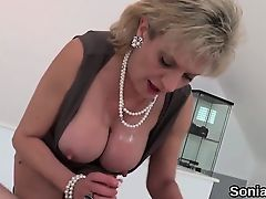Adulterous english mature lady sonia exposes her monster tit