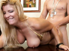 Blonde Robbye Bentley with giant breasts and hairless muff and