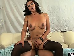 Busty shemale gets her ass pounded