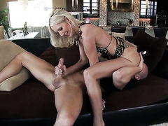 Emma Starr with huge knockers gives blowjob to Johnny Sins