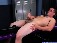 Handsome stud tugging in the locker room