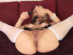 Well-endowed blonde MILF Sarah Vandella in white stockings spreads her