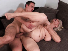Dangerously sexy sex kitten with massive boobs plays with