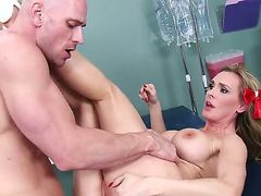 Hot blonde doctor with giant boobs is attracted to her new patient Johnny Sins.