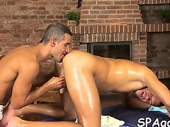 Homosexual man is engulfing dick hungrily during massage
