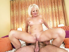 Blonde wench with giant jugs gets cummed