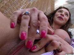 Busty Colombian MILF Ariella Ferrera shows her neatly trimmed bush